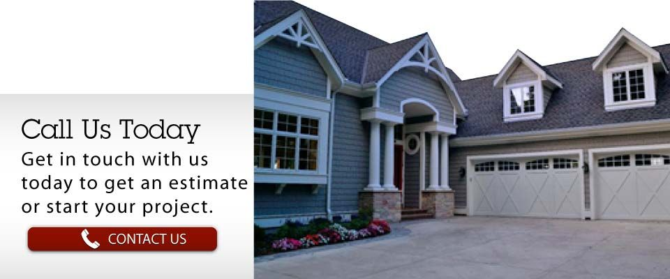 Call Us Today | Get in touch with us today to get an estimate or start your project. | Home with new garage doors